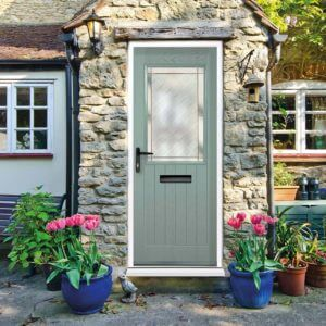 Green entrance door with glass panel and black hardware