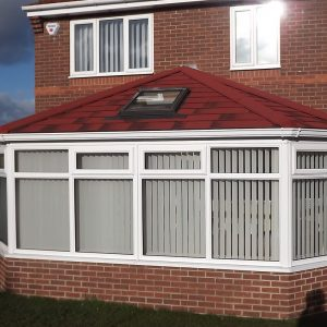 Red tiled roof on uPVC conservatory