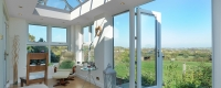 White uPVC orangery interior with a french door