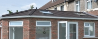 Home extension with a brown tiled roof
