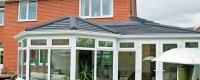 P Shaped conservatory with a black tiled roof