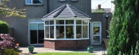 uPVC victorian conservatory with a black tiled roof