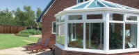 White uPVC victorian conservatory with glass roof