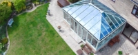 Large glass conservatory installation with PVCu windows and doors