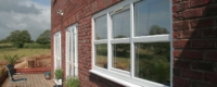 External view of tilt and turn PVCu windows in white