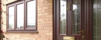 uPVC front entrance door installed with detailed glazing and traditional ponytail door knocker