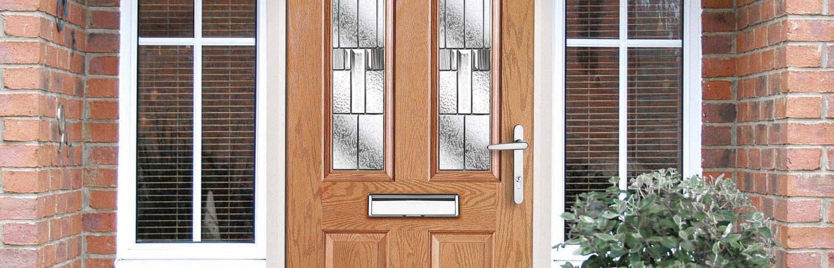 Security entrance gate glazed decorative security entrance doors - A Green Entrance Door With Traditional Design And Decorative Glass Front Door In Oak Woodgrain Colour With Chrome Handle And Letterplate