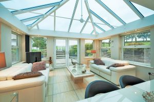 Conservatory with glass roof and modern interior