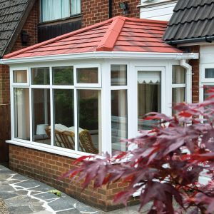 White uPVC conservatory with a red tiled roof