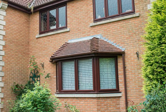 Rosewood uPVC bay window and casement windows