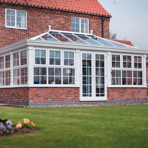 White uPVC orangery with a lantern roof