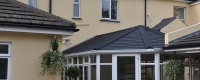 Black tiled roof and glazed windows