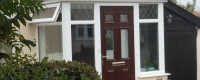 White uPVC porch with a rosewood door