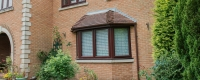 uPVC rosewood bow window