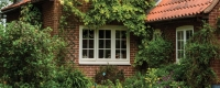 Cream uPVC casement window installation