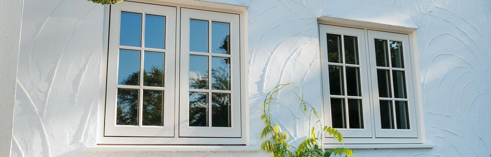 White double glazed windows with flush sash for traditional appearance