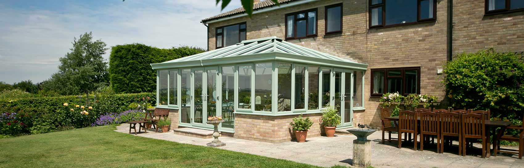 Glazed conservatory in Chartwell green PVCu