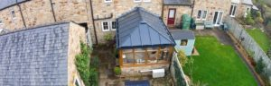 Oak colour PVCu conservatory with LivinRoof roof system