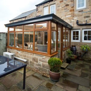 Oak conservatory with LivinRoof installation