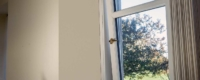 A tilt and turn window installation that over looks the garden