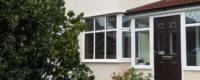 A White PVCu porch with diamond leaded windows