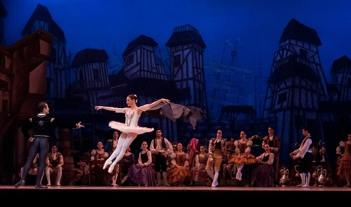 Ballerina jumping on a theatre stage